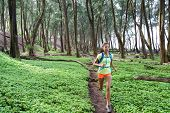 Trail ultra running sport runner athlete woman sprinting in forest green grass. Sport sprinter activ poster