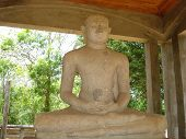 stock photo of samadhi  - Samadhi Buddha statue at Maha Mewna Garden at Anuradhapura - JPG