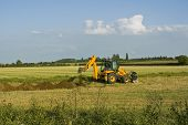 stock photo of jcb  - digger in countryside digging holes in the ground - JPG
