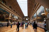 Crowds of tourists visit the Palace of Versailles and Gallery of Battles