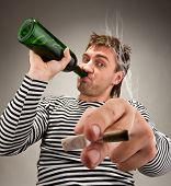 Drunk bizarre sailor with bottle and cigarette