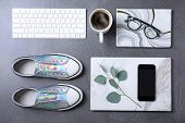 Flat Lay Composition With Keyboard And Fashion Bloggers Stuff On Stone Surface poster