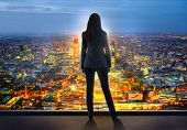 Young Woman Looking Over The City Of London Business And Banking Area With Skyscrapers At Sunset. Fu poster