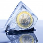 picture of stagnation  - Euro coin frozen into the ice cube - JPG
