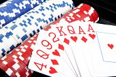 Red Poker Cards And Different Colour Of Chips