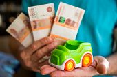 Car And Money In Male Hands, Car Loan Concept, Saving Money For Car Concept, Trade Car For Cash Conc poster