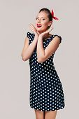 Portrait Of Surprised Pin Up Woman In Polka Dot Dress. Cute Girl Posing In Retro Style poster