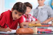 Little boy working in a classroom