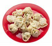Dumplings On A Red  Plate Isolated On White Background .boiled Dumplings.meat Dumplings Top Side Vie poster