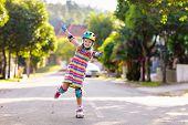 Child On Inline Skates. Kids Skate Roller Blades. poster