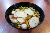 Authentic Thai Noodle Soup With Fishballs, Wontons And Vegetables (yen Ta Fo) poster