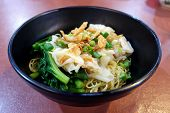 Chinese Egg Noodles With Wontons And Vegetables poster