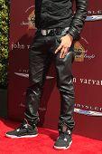 LOS ANGELES - MAR 11:  Taboo of the Black Eyed Peas arrives at the 9th Annual John Varvatos Stuart House Benefit at the John Varvatos Store on March 11, 2012 in West Hollywood, CA