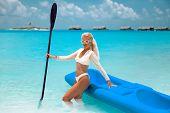 Sexy Blond Bikini Model Paddling A Kayak. Woman Exploring Calm Tropical Bay. Maldives. Sport, Recrea poster