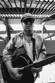 Bluesman With Acoustic Guitar In Grayscale. Cool Guy Plays Guitar. Performance Of Wandering Blues Mu poster
