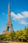 The Eiffel Tower in the blue sky