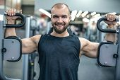 Smiling Strong Bodybuilder Athletic Man Pumping Up Muscles Workout Bodybuilding Concept Background - poster