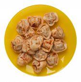 Dumplings On A Yellow Plate Isolated On White Background. Dumplings In Tomato Sauce. Dumplings Top V poster