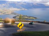 foto of luge  - Riding Luge down the hill with Queenstown view on the horizon - JPG