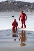 SPARTA, NJ - FEB 20: Two members of the Sparta Volunteer Fire Dept in orange immersion suits near an