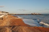 HASTINGS, ENGLAND - JANUARY 1: The shingle beach and Victorian pier on January 1, 2013 at Hastings,