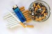 Cigarettes And Blue Lighter, Ashtray With White Back Ground