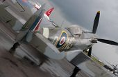 stock photo of spitfire  - Spitfire on a landing field in rain - JPG