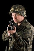foto of m16  - Watchful soldier with m16 in the hands - JPG