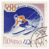 Skier On A Steep Mountain Slope On Post Stamp