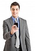 Handsome businessman using his cell phone. Isolated on white