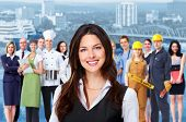 Business woman and group of industrial workers people. Over urban background.