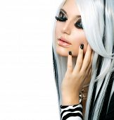 Beauty Fashion Girl black and white style. Long White Hair with Black Stripes. Smoky Eyes Makeup. Bl