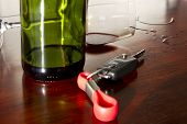 Bottle of wine with car key
