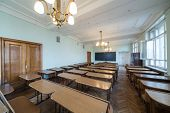 MOSCOW - MAY 13: Classroom with tables and chandeliers in the Faculty of Physics in Moscow State Uni