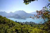 stock photo of annecy  - lake of Annecy with a small village - JPG