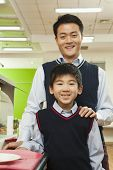 Teacher and school boy portrait in school cafeteria