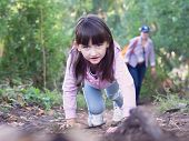 image of pharyngitis  - Young girl walking at the green forrest - JPG