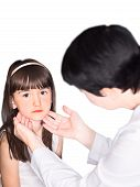 image of pharyngitis  - Doctor and the girl isolated white background - JPG