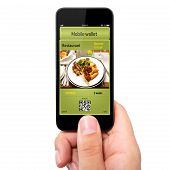 Isolated Man Hand Holding The Phone With A Mobile Wallet And Ticket Discount In Restaurant