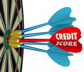 The word Credit Score on a dart hitting the bulls-eye target on a dartboard to illustrate getting the best number or rating when securing financing or a loan
