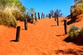 Orange Sandy Path Going Uphill In Australian Outback