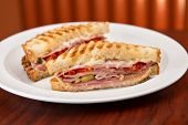 stock photo of deli  - An Italian deli classic ham salami and provolone sandwich on sourdough bread - JPG
