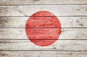 japanese flag on wood texture background