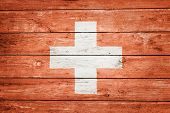 swiss flag on wood texture background