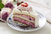 slice of layered cake with berry mousse and with chocolate icing