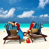 picture of couple sitting beach  - Couple on a tropical beach at Maldives - JPG
