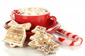 Cup of coffee with Christmas sweetness isolated on white
