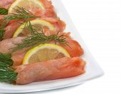 Close-up Of Plate With Smoked Salmon On White Background.