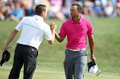 Sep 15, 2013; Lake Forest, IL, USA; Tiger Woods (r) shakes hands with Sergio Garcia on the 18th gree