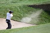 Sep 15, 2013; Lake Forest, IL, USA; Sergio Garcia hits out of a bunker on the eighth hole during the